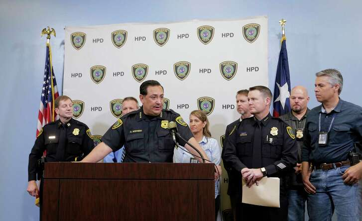 Houston Police Chief Art Acevedo and members of the HPD's major offenders division hold a press conference announcing the recovery of Patriots quarterback Tom Brady's jersey. ( Elizabeth Conley / Houston Chronicle )