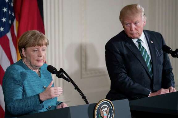 German Chancellor Angela Merkel, accompanied by President Donald Trump, speaks at a joint March 17 news conference in the East Room of the White House. (AP Photo/Andrew Harnik)
