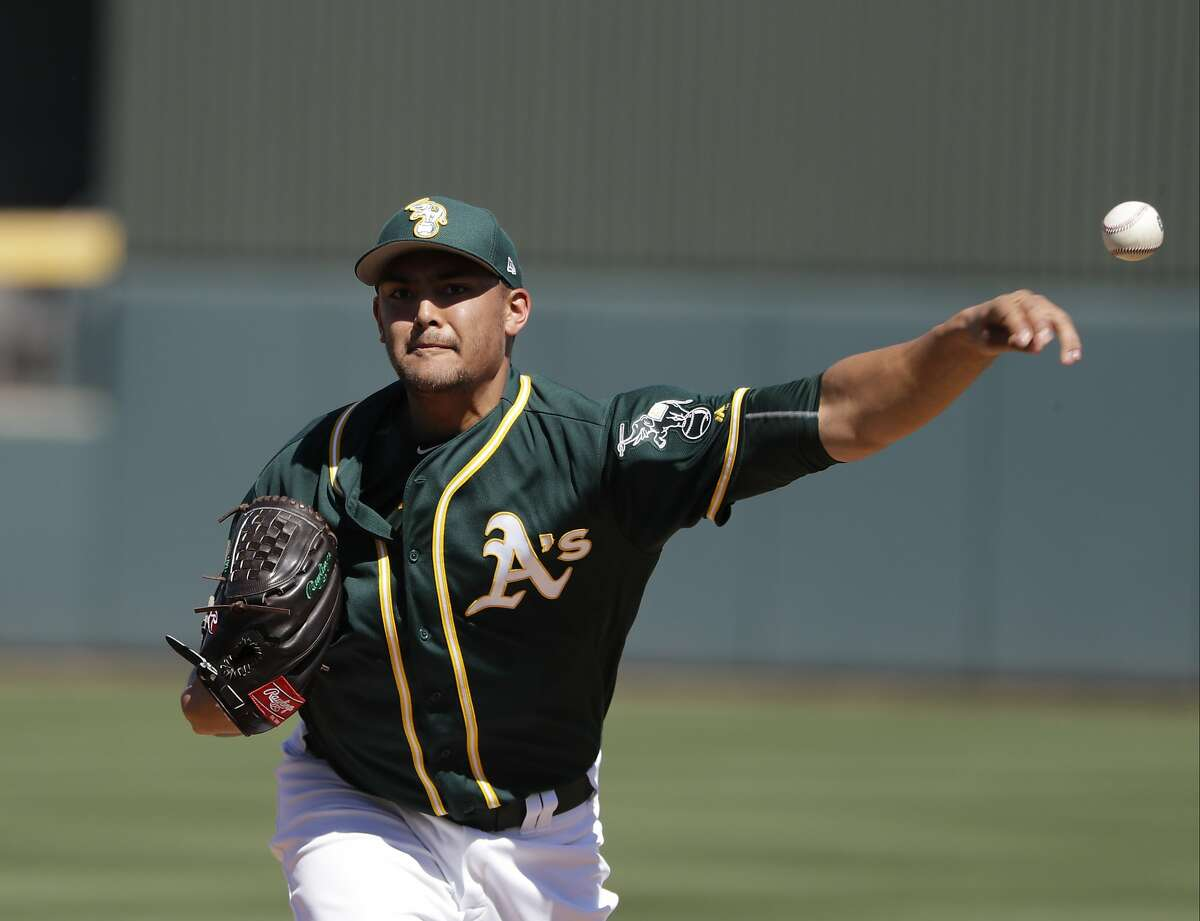 Sean Manaea pitches against the Cincinnati Reds in Mesa, Ariz., during spring training on March 9.