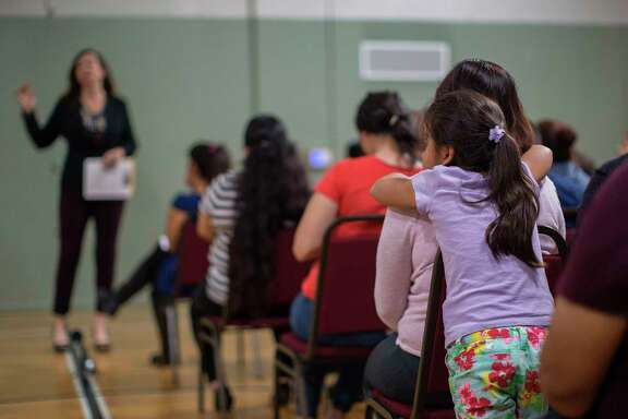 A girl watches during a workshop for immigrants to make a preparedness plan, in case they are confronted by immigration officials, at Academia Avance charter school where 48-year-old father of four, Romulo Avelica-Gonzalez, was arrested by ICE agents when he dropped off his daughter for school on March 9 in Los Angeles. / AFP PHOTO / DAVID MCNEWDAVID MCNEW/AFP/Getty Images