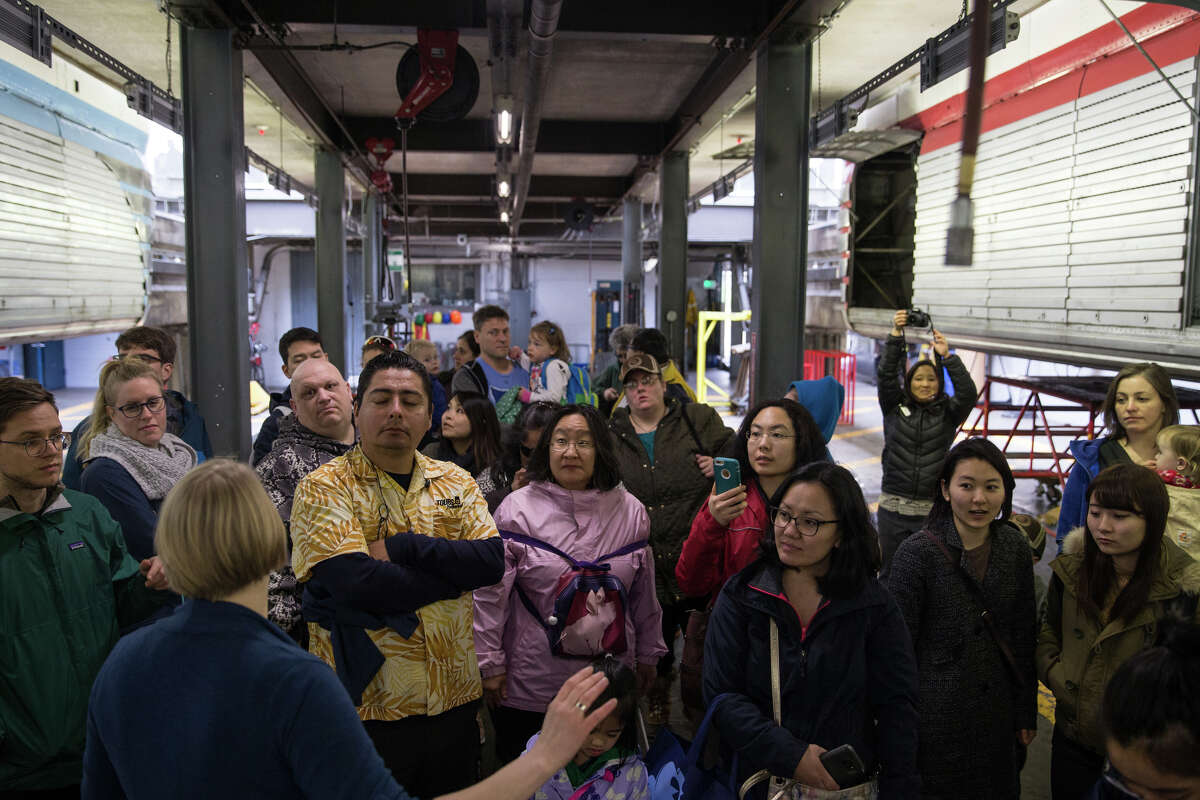 Dr. Eno Yliniemi, chief systems engineer for the Seattle Center Monorail, leads a tour of the train and its service center in celebration of 55 years of service, at the Seattle Center, on Friday, March 24, 2017.
