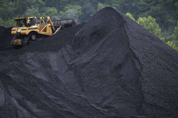 A bulldozer operates atop a coal mound, in this 2014 photo, at the CCI Energy Slones Branch Terminal in Shelbiana, Ky. (Photo by Luke Sharrett/Getty Images)
