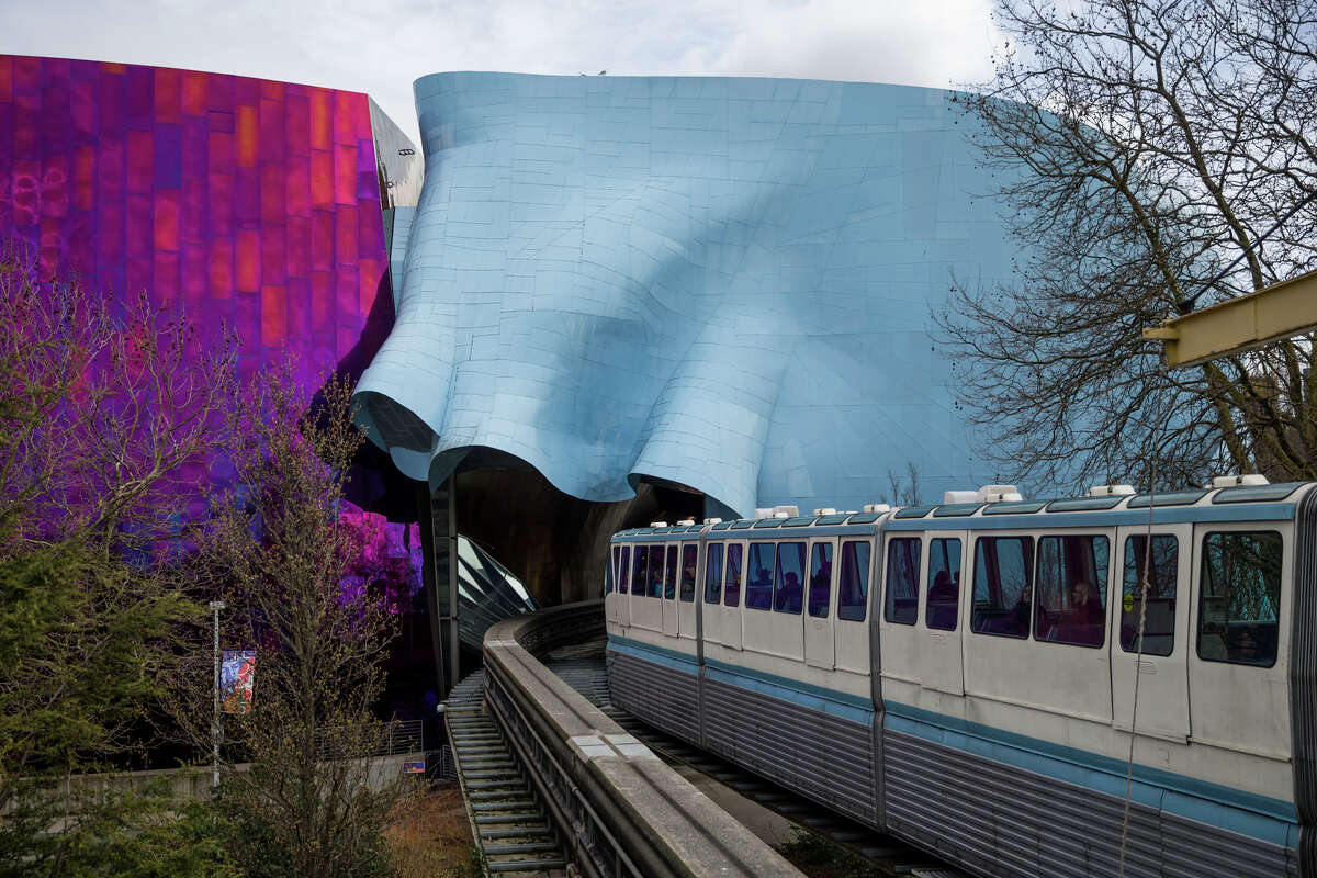 The Seattle Center Monorail heads under MoPOP, on Friday, March 24, 2017.