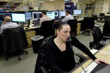 In this Jan. 12, 2017, photo, traders work on the Mizuho Americas trading floor in New York. Stocks are opening higher on Wall Street, on Friday, March 24, 2017, led by gains in technology companies and banks. (AP Photo/Mark Lennihan) ORG XMIT: NYML513