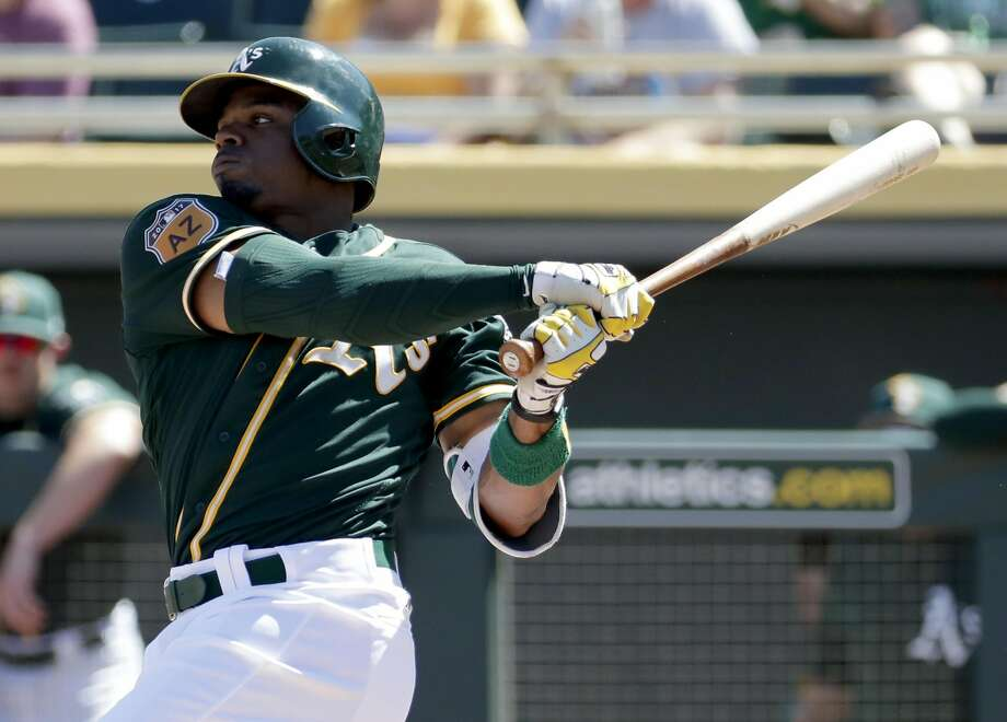 Oakland Athletics center fielder Rajai Davis hits against the San Diego Padres during the second inning of a spring training baseball game, Saturday, March 18, 2017, in Mesa, Ariz. (AP Photo/Matt York) Photo: Matt York, Associated Press