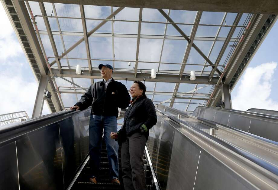 BART's Warm Springs extension project manager Paul Medved and spokeswoman Molly McArthur ride the escalator of the new station in Fremont. Photo: Paul Chinn, The Chronicle