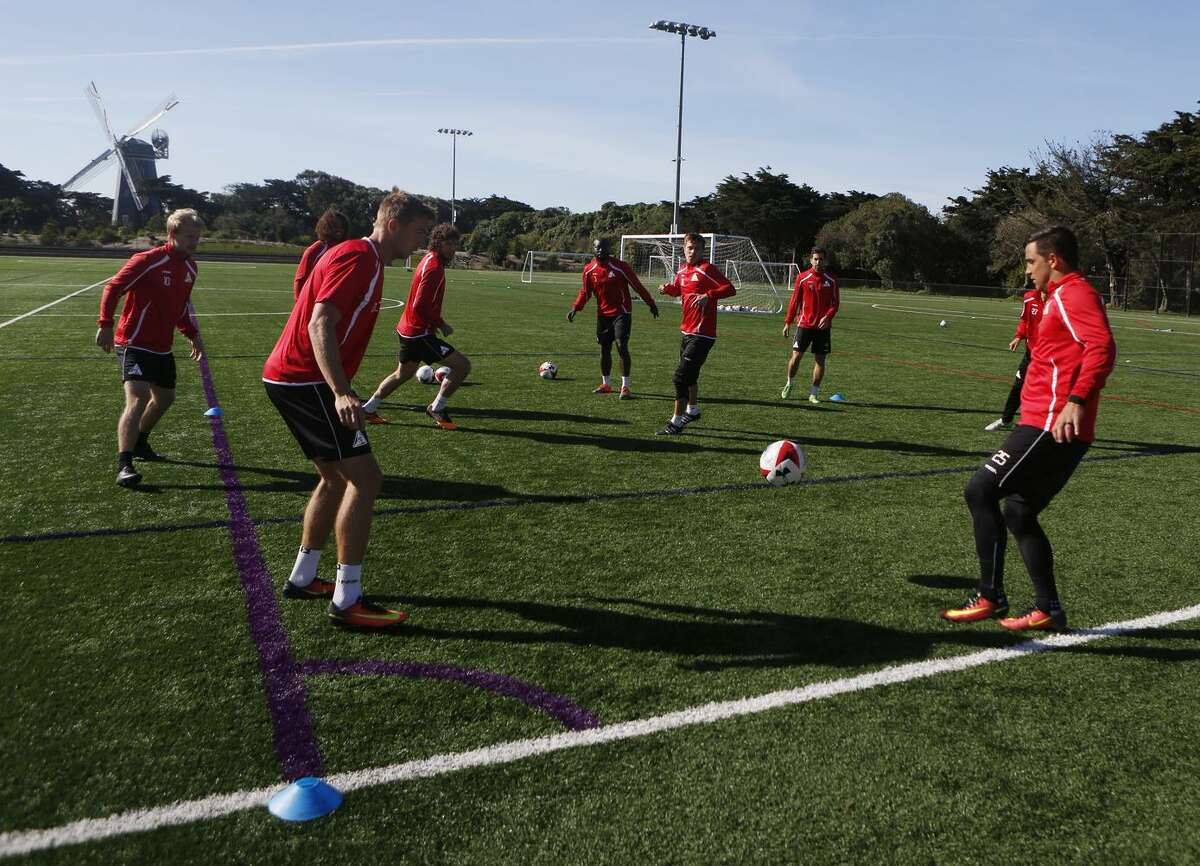 Members of the new professional soccer team, the S.F. Deltas, practice at the Beach Chalet soccer fields in Golden Gate Park last week.