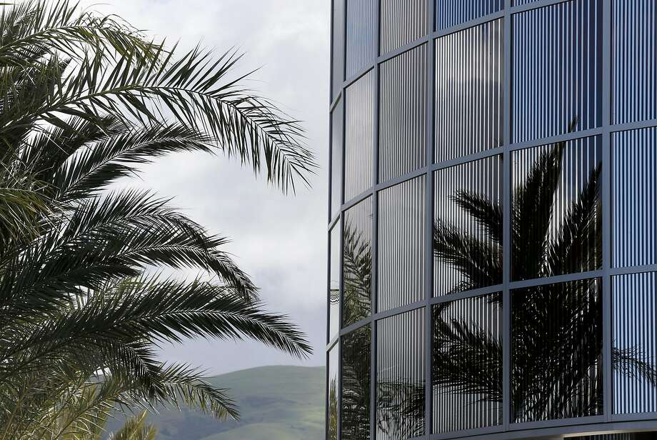 Palm trees are reflected in the drum-like rotunda of glass panels at the entrance to the new Warm Springs BART Station in Fremont. Photo: Paul Chinn, The Chronicle