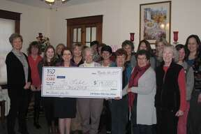 More than a dozen members of the 100 Women Who Care group visited the office of To Life! on March 22. It presented contributions from members totaling $13,000, their largest contribution to a single organization to date. Members of To Life! board of directors, staff and friends were on hand for the event. To Life! will use the funds to expand program outreach in the Capital Region. (Photo provided)