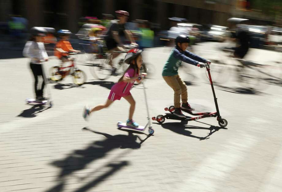 Kids on skateboard join others during the 10th scolova in downtown San Antonio. Photo: Ronald Cortes /