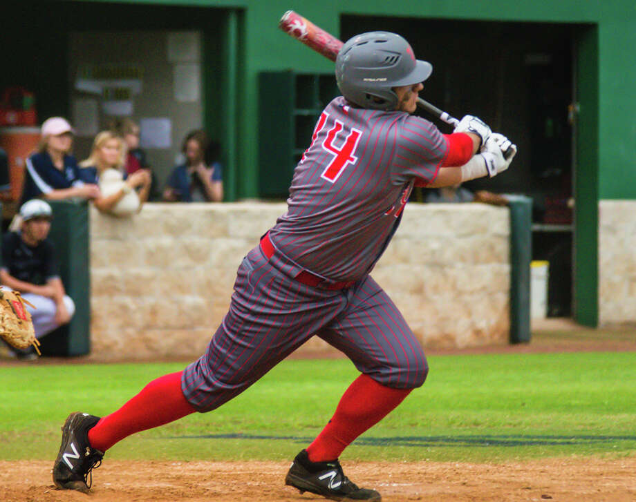 The Woodlands Jared Miles connects on a base hit against College Park at the Diamonds at College Park in The Woodlands on Friday. Photo: Keith MacPherson