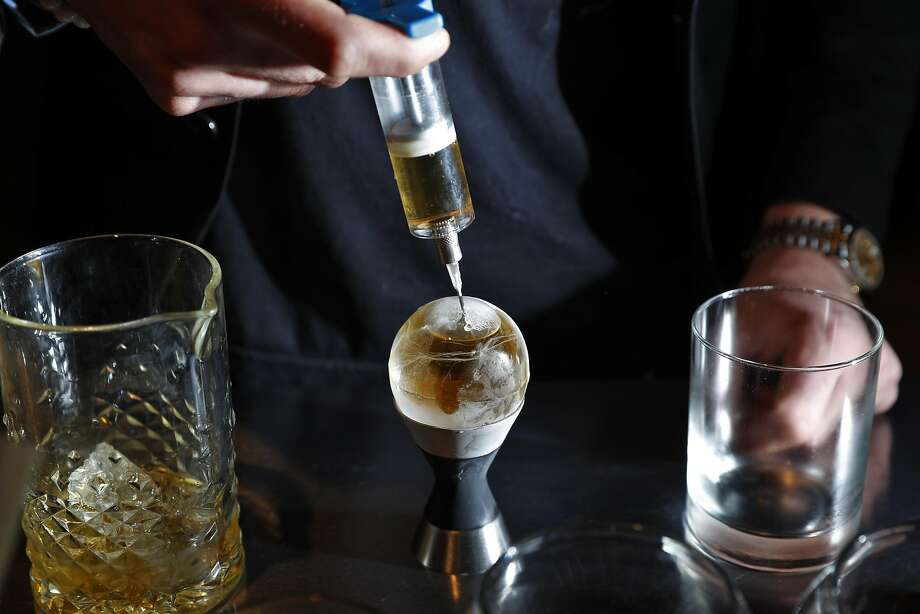 Bar director and Modernist partner Carlo Splendorini injects spirits into ice to make a Pokeball cocktail at The Modernist. Photo: Carlos Avila Gonzalez, The Chronicle