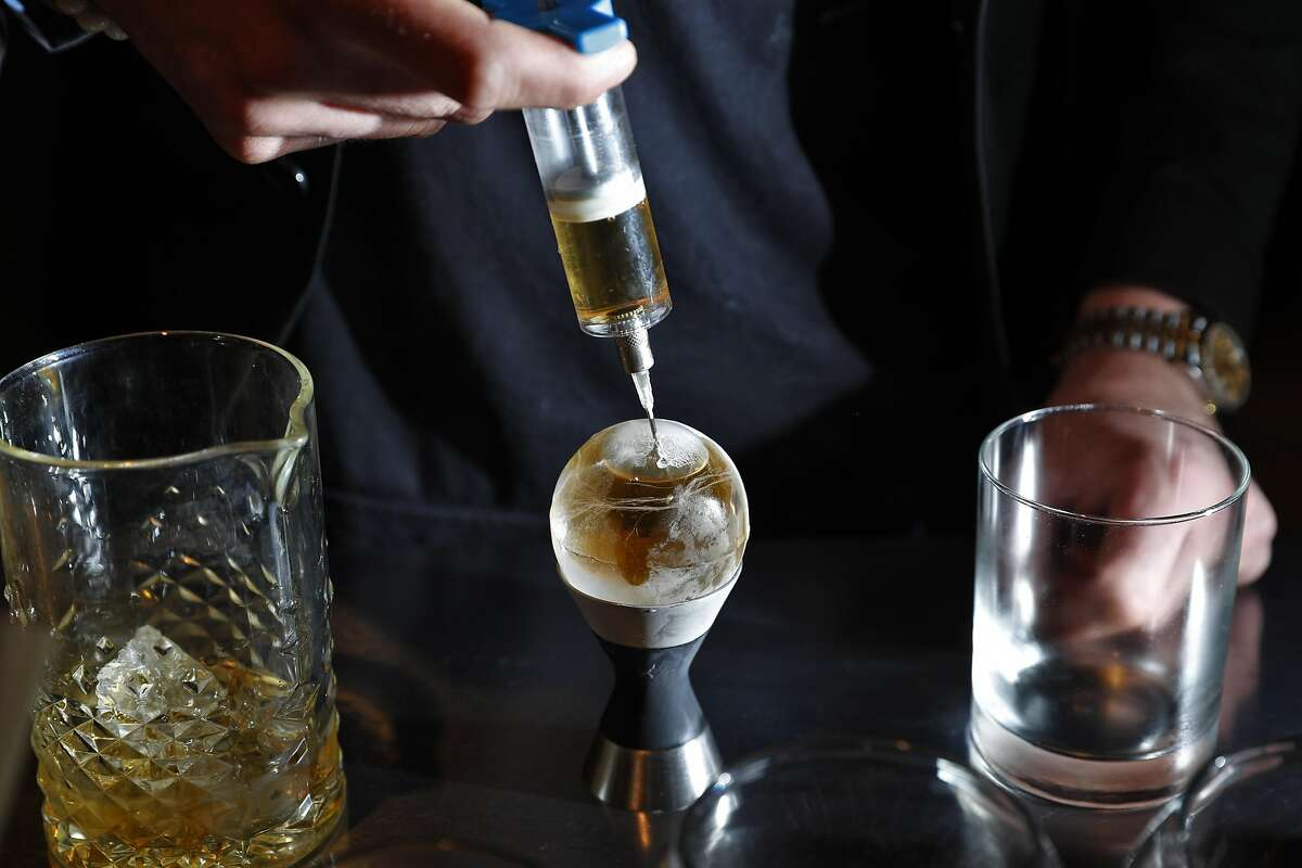 Bar chef Carlo Splendorini injects spirits into a hollow sphere of ice to make a Pokeball cocktail containing Kikori Whiskey, salted caramel, and aged balsamic vinegar during a member dinner at The Modernist social club in San Francisco, Calif., on Wednesday, March 22, 2017. The year-old social/dining club The Modernist (founded by Cako and A5A steakhouse founder Albert Chen) isn't interested in being your parent's social club. Membership has nothing to do with legacies, last names or industry standing, the club just wants to create a friendly, social vibe for people interested in adventurous microgastronomy dining experience and making new friends.