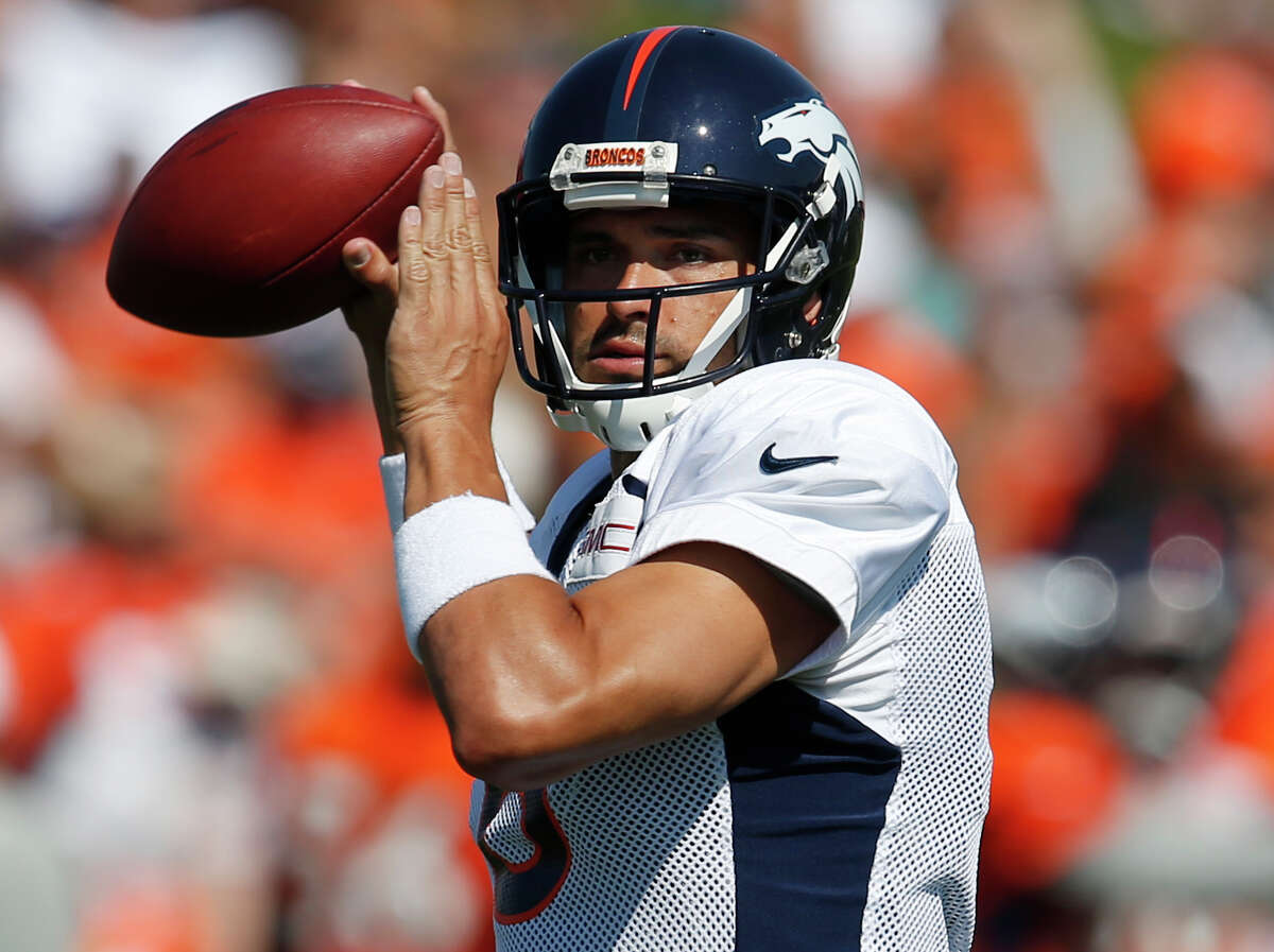 FILE - In this July 31, 2016, file photo, then-Denver Broncos quarterback Mark Sanchez takes part in drills during the team's NFL football training camp in Englewood, Colo. The Chicago Bears continued their quarterback makeover Friday, March 24, 2017, by signing veteran Mark Sanchez, who is expected to back up Mike Glennon next season.(AP Photo/David Zalubowski, File) ORG XMIT: NY199