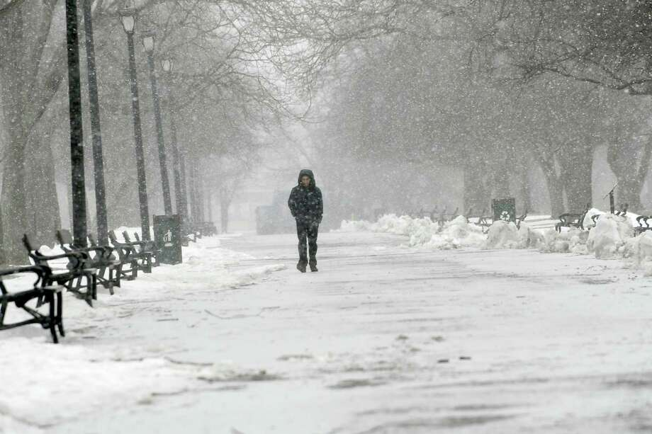 Bhim Bhandari of Albany walks through Washington Park as snow falls on Friday, March 24, 2017 in Albany, N.Y. ( Lori Van Buren / Times Union) Photo: Lori Van Buren