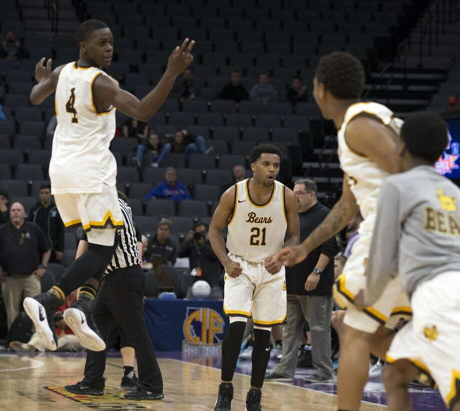 Mission players exult as the clock expires in their CIF Boys Division III high school state championship basketball game against Villa Park on Friday, March 24, 2017 in Sacramento, Calif. Mission won in overtime 82-75. Photo: D. Ross Cameron, Special To The Chronicle
