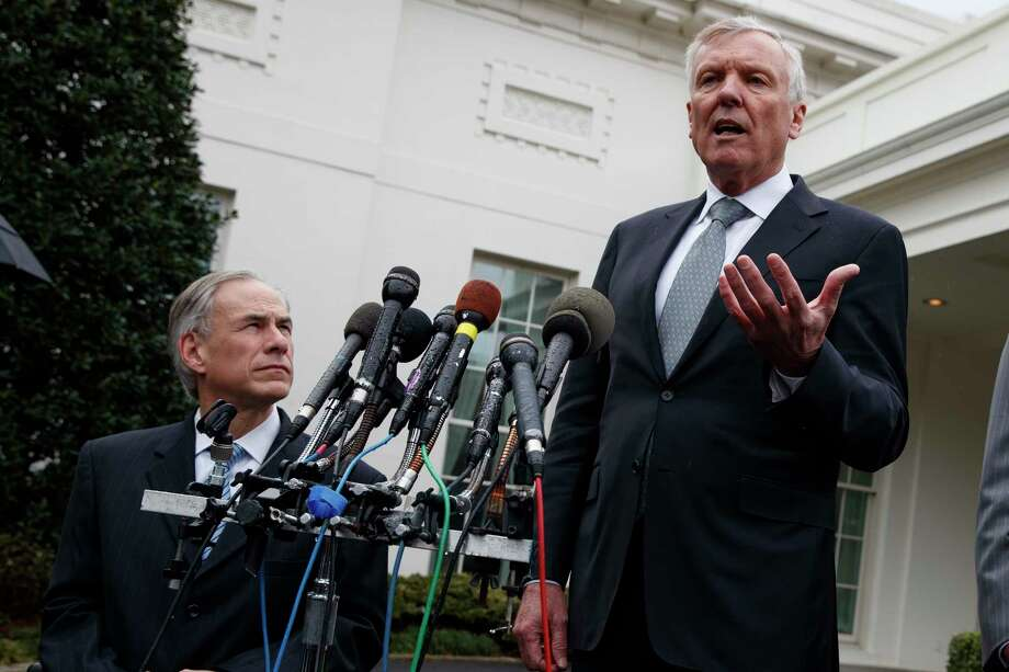 Texas Gov. Greg Abbott listens at left, as Charter Communications CEO Thomas Rutledge speaks to reporters outside the White House in Washington, Friday, March 24, 2017, after meeting with President Donald Trump. (AP Photo/Evan Vucci) Photo: Evan Vucci, STF / Copyright 2017 The Associated Press. All rights reserved.