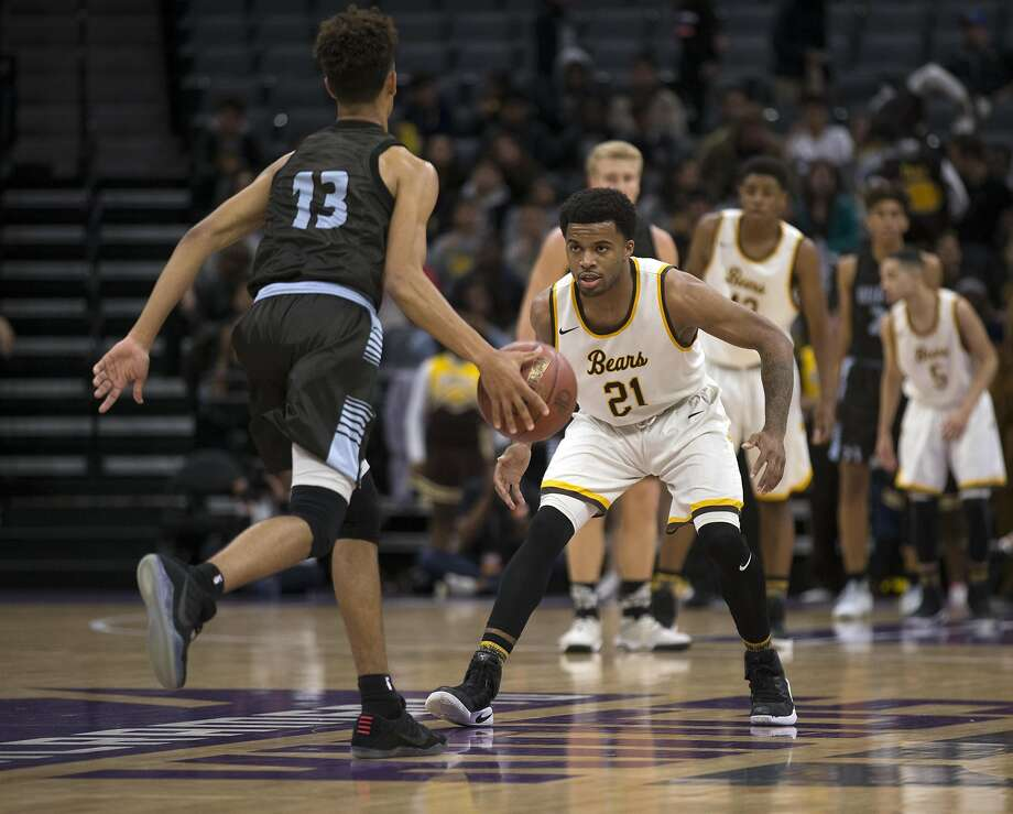 Mission�s Niamey Harris (21) plays defense as Villa Park�s Myles Franklin (13) brings the ball up court during the first quarter of their CIF Boys Division III high school state championship basketball game on Friday, March 24, 2017 in Sacramento, Calif. Mission won in overtime 82-75. Photo: D. Ross Cameron, Special To The Chronicle