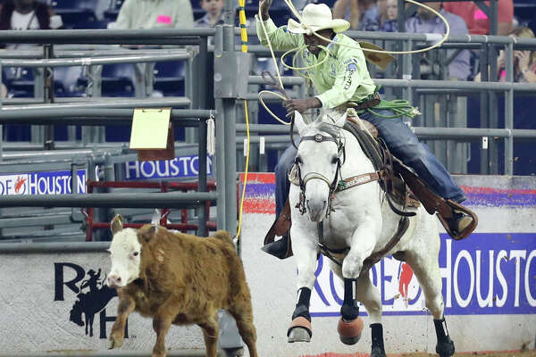 Cory Soloman, of Prairie View, chases down a steer during the tie-down roping wild card competition at the Houston Livestock Show and Rodeo at NRG Park, Friday, March 24, 2017, in Houston. ( Karen Warren / Houston Chronicle )