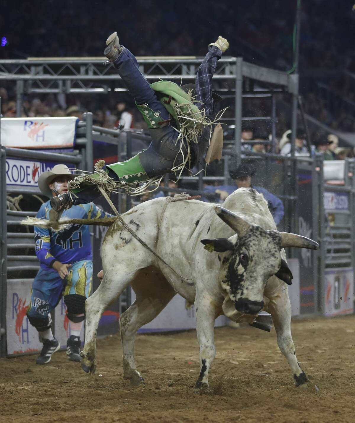 Aaron Pass gets tossed into the air by Wild N Free during the bull riding, wild card competition at the Houston Livestock Show and Rodeo at NRG Park, Friday, March 24, 2017, in Houston. ( Karen Warren / Houston Chronicle )