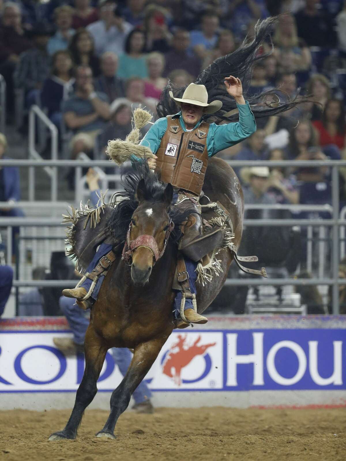 Clay Elliot rides Urgent Delivery putting him in first place during the saddle bronc riding, wild card competition at the Houston Livestock Show and Rodeo at NRG Park, Friday, March 24, 2017, in Houston. ( Karen Warren / Houston Chronicle )