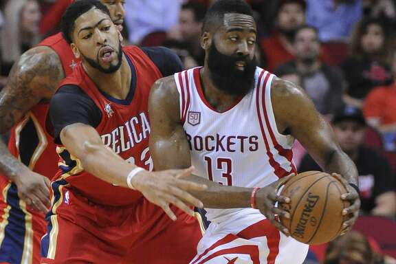 New Orleans Pelicans forward Anthony Davis (23) Anthony Davis (23) guards Houston Rockets guard James Harden (13) in the first half of an NBA basketball game Friday, March 24, 2017, in Houston. (AP Photo/George Bridges)