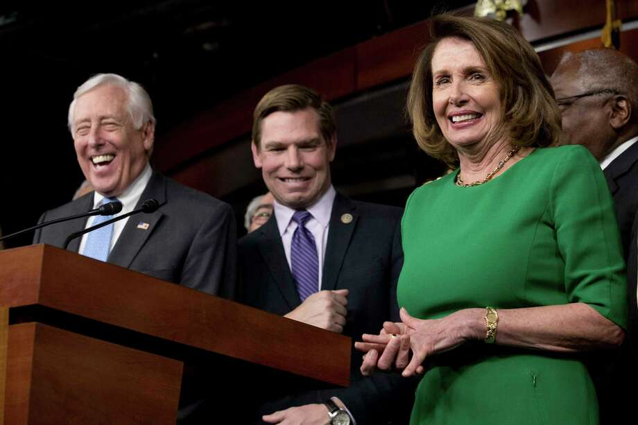 House Minority Leader Nancy Pelosi of Calif., right, and Democratic Whip Steny Hoyer, D-Md., left, react at a joke from Rep. Eric Swalwell, D-Calif., center, during a news conference on Capitol Hill in Washington, Friday, March 24, 2017. Pelosi and Hoyer have both recently talked up Democrat changes in the midterms. Photo: Andrew Harnik / Copyright 2017 The Associated Press. All rights reserved.