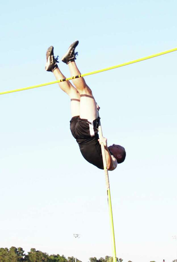 Coldspring-Oakhurst Trojan Chad Currie makes his way over the bar in the pole vaulting competition held as part of the Tarkington Longhorn Relays. Photo: Jacob McAdams
