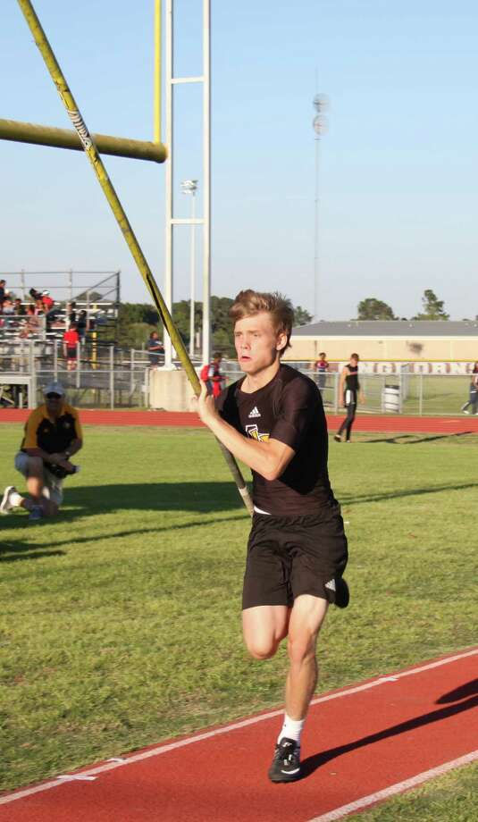 Liberty Panther Dylan Westberry charges forward with his pole in the boys pole vaulting competition at the Tarkington Longhorn Relays. Photo: Jacob McAdams