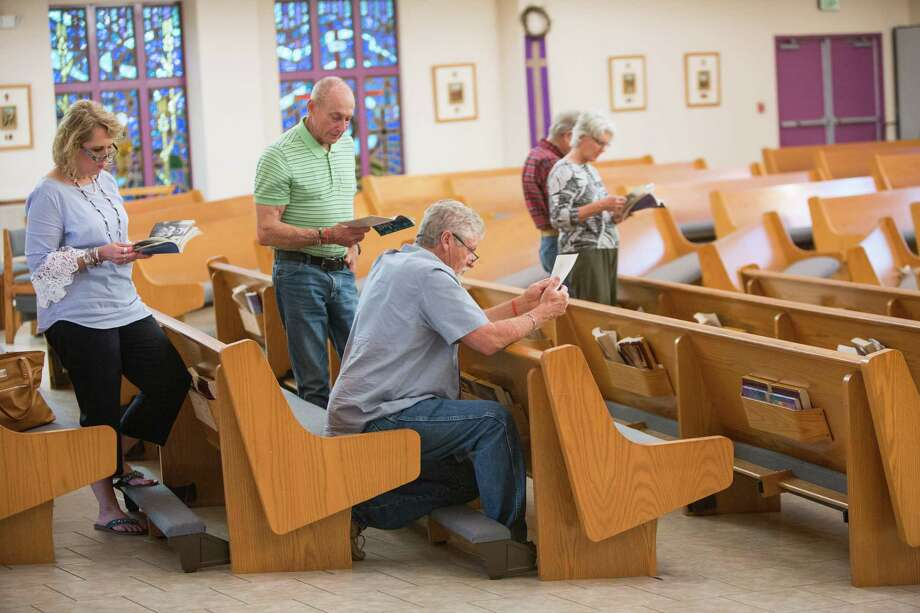 People pray during the Friday night Pentecostal service at the St Ann's Catholic Church in La Vernia, Texas. Photo: Federica Valabrega