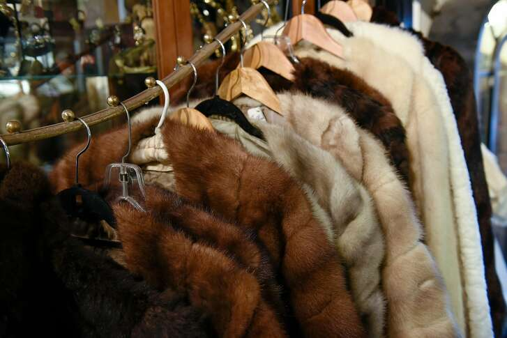 Furs for sale hang on racks as Cicely Hansen, owner of Decades of Fashion, holds a press conference at her store with her lawyer Sanford Troy, to discuss recent charges that she sold clothing items made from endangered species, in San Francisco, CA, on Friday March 24, 2017.
