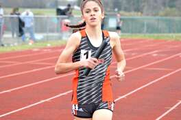 Edwardsville freshman Abby Korak competes in the girls' distance medley on Friday during the Southwestern Illinois Relays at the Winston Brown Track and Field Complex.