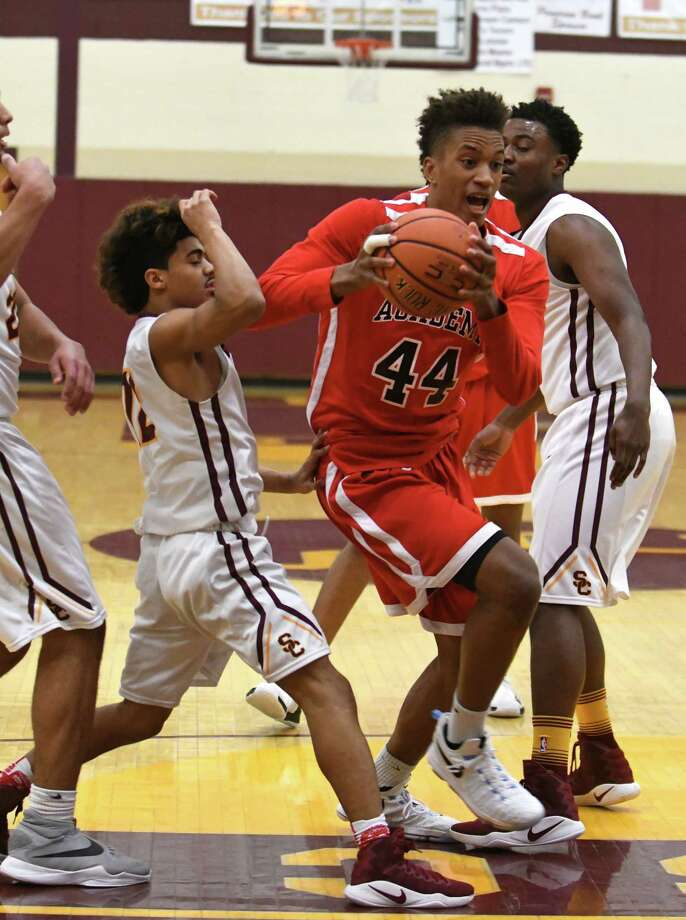 Albany Academy's Hameir Wright drives to the basket during their high school basketball game against Colonie on Saturday Dec. 31, 2016 in Colonie, N.Y. (Michael P. Farrell/Times Union) Photo: Michael P. Farrell / 20039277A