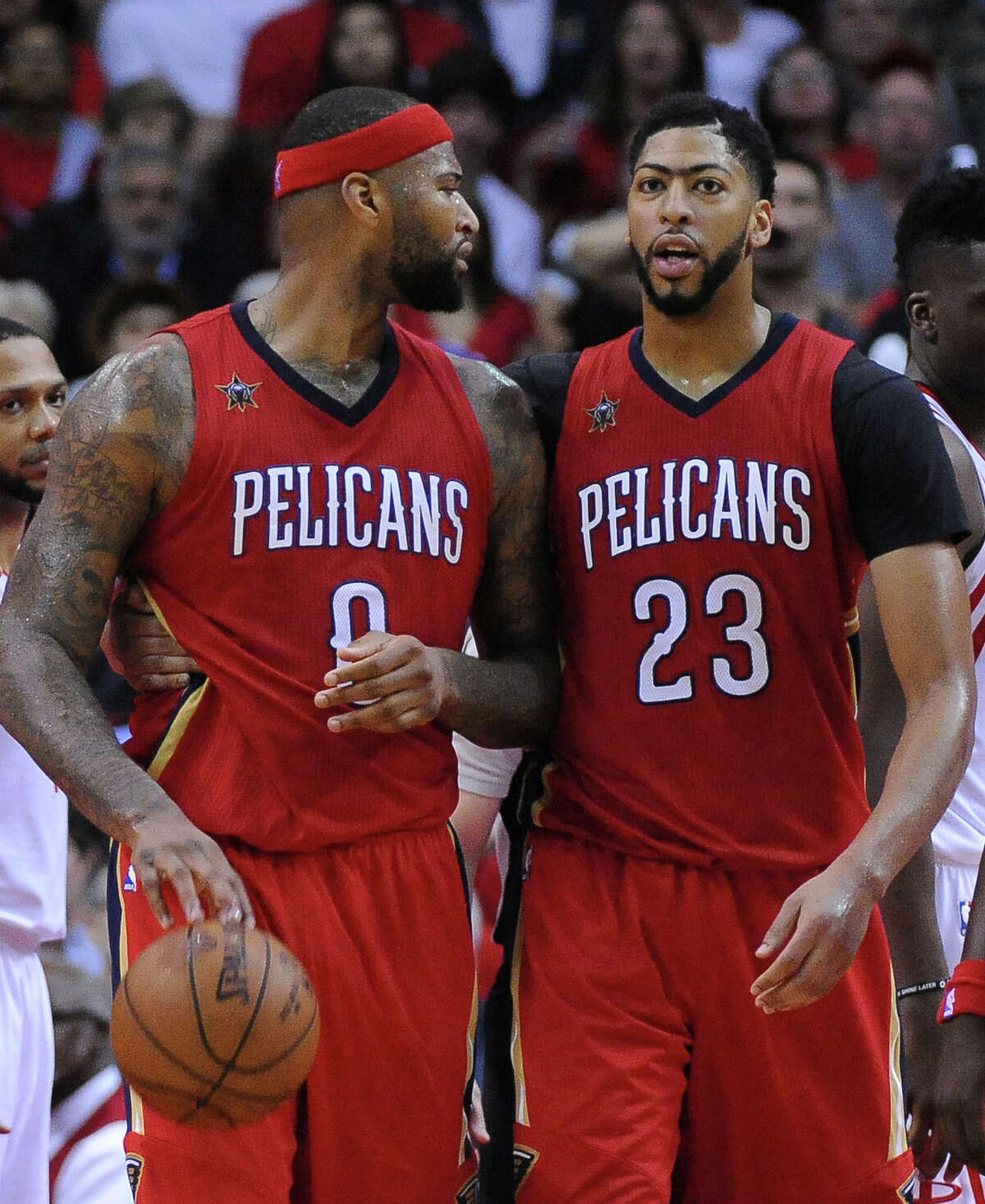 New Orleans Pelicans forward Anthony Davis (23) Anthony Davis (23) pulls DeMarcus Cousins (0) away from an altercation against the Houston Rockets in the second half of an NBA basketball game Friday, March 24, 2017, in Houston. (AP Photo/George Bridges)
