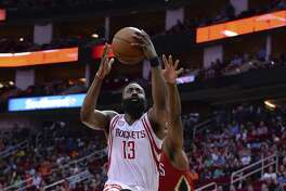 Houston Rockets guard James Harden (13) goes up for a basket in front of New Orleans Pelicans forward Solomon Hill, right, in the second half of an NBA basketball game Friday, March 24, 2017, in Houston. (AP Photo/George Bridges)
