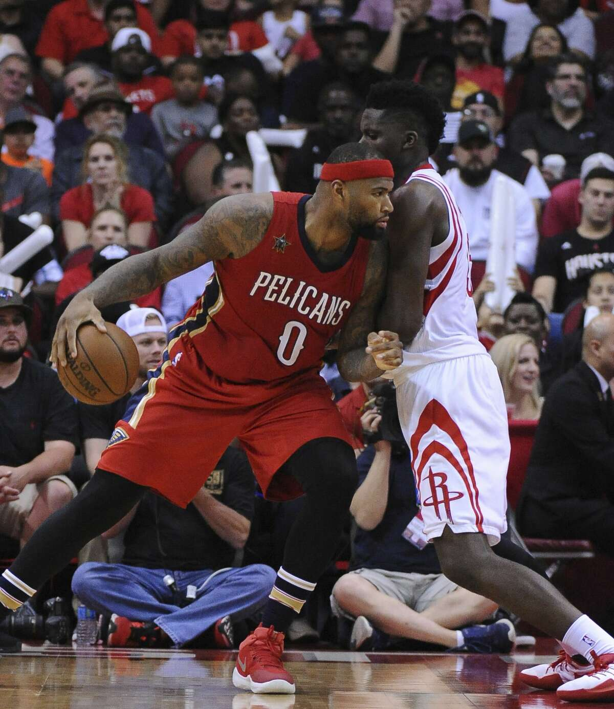 New Orleans Pelicans forward DeMarcus Cousins (0) works against Houston Rockets center Clint Capela, right, in the second half of an NBA basketball game Friday, March 24, 2017, in Houston. (AP Photo/George Bridges)