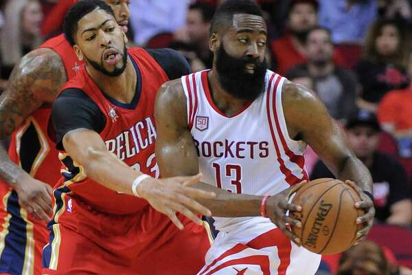 James Harden, right, tries to figure out where to go with the ball while pressured by Anthony Davis.