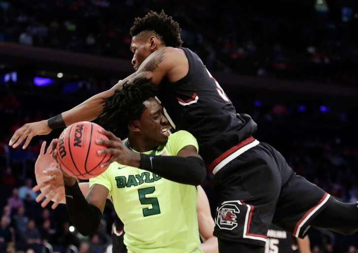 Although this may have been a tad too close for comfort by the referees' standards, Chris Silva, right, and his South Carolina teammates made life difficult for Baylor forward Johnathan Motley in Thursday night's East Regional semifinal.