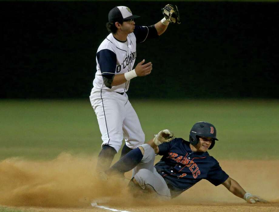 Brandeis' Ryan McGowen slides into third base under O'Connor's Bo Gonzales during the first inning on March 24, 2017 at Inselmann Field. Photo: Edward A. Ornelas /San Antonio Express-News / © 2017 San Antonio Express-News