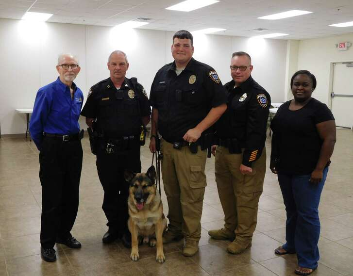 Members of the Cleveland Rotary Club were visited by Cleveland ISD Police Officers Justin Edwards and John Shannon as well as Officer Tex, the 4-year old German Shepherd K-9 narcotics/search and rescue dog.  Officer Edwards and Officer Tex have many hours of intensive training to keep Cleveland students safe.  CISD Police Chief Rex Evans also visited.  Rotarians were amazed by and grateful for the wonderful CISD Police team (human and canine) – and appreciate the contribution by Rotarian Alfred Anderson of Anderson Ford to sponsor Officer Tex.  Pictured (left to right) are  Rotarian Tommie Daniel, Officer Shannon, Officer Tex, Officer Edwards, Chief Evans and Rotary President Eisha Jones.