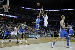 Kentucky guard De'Aaron Fox shoots against UCLA in the first half of an NCAA college basketball tournament South Regional semifinal game Friday, March 24, 2017, in Memphis, Tenn.