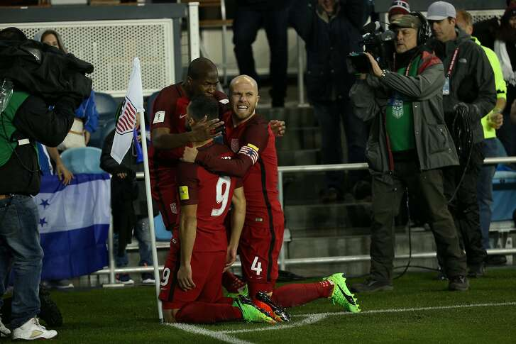 USA midfielder Sebastian Lletget (9) reacts with teammates midfielder Michael Bradley (4) during the first half of a CONCACAF Gold Cup Group stage soccer match at Avaya Stadium on Friday, March 24, 2017, in San Jose, Calif. U.S.A leads 3-0 at half time.