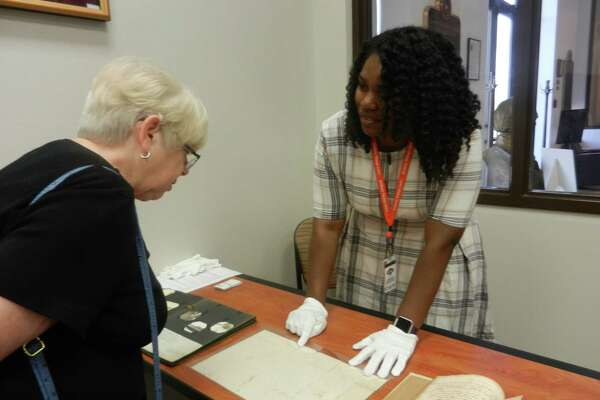 Texas State Archives Staff welcomed local residents to the Sam Houston Center with hands-on displays of archival artifacts and documents.