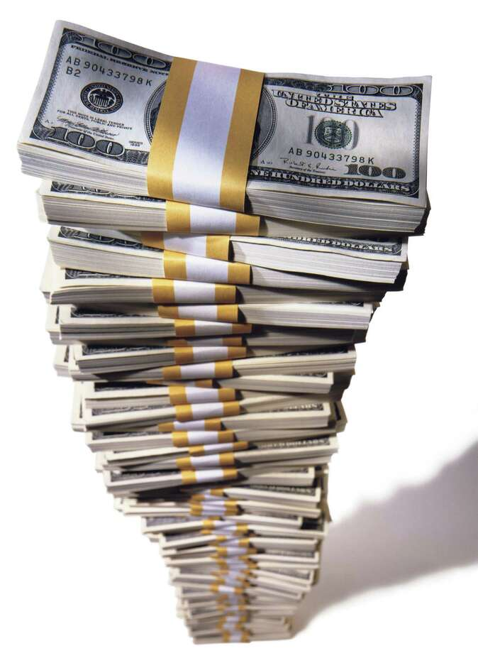 tall stack of $100 dollar bills Photo: Martin Mistretta, Contributor / This content is subject to copyright.
