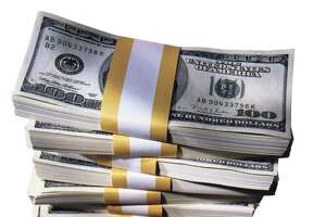 tall stack of $100 dollar bills