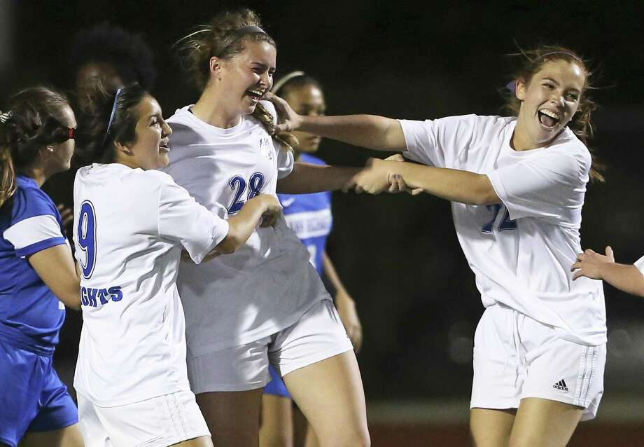 Mules players celebrate a goal with Katherine Detmer who deflected a corner kick into the net as  Alamo Heights plays Richards at Orem Stadium in a class 5A bidistrict playoff on March 24, 2017. Photo: Tom Reel, Staff / San Antonio Express-News / 2017 SAN ANTONIO EXPRESS-NEWS