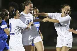 Mules players celebrate a goal with Katherine Detmer who deflected a corner kick into the net as  Alamo Heights plays Richards at Orem Stadium in a class 5A bidistrict playoff on March 24, 2017.