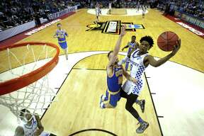 MEMPHIS, TN - MARCH 24: De'Aaron Fox #0 of the Kentucky Wildcats drives to the basket against Bryce Alford #20 of the UCLA Bruins in the second half during the 2017 NCAA Men's Basketball Tournament South Regional at FedExForum on March 24, 2017 in Memphis, Tennessee.  (Photo by Andy Lyons/Getty Images) ORG XMIT: 686517843