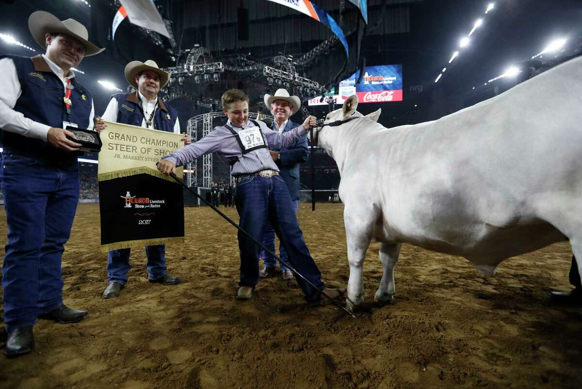 """Jagger Horn of Anson celebrates his steer """"Playa"""" being named the Junior Market Steer champion at the Houston Livestock Show and Rodeo on Friday at NRG Park. The 1,283-pound Charolais steer will be auctioned today."""