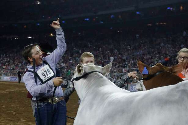 """Jagger Horn of Anson is thrilled after his steer """"Playa"""" was named grand champion at the Houston Livestock Show and Rodeo on Friday at NRG Park."""